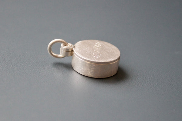 silver floating locket with custom name with forget me not seeds