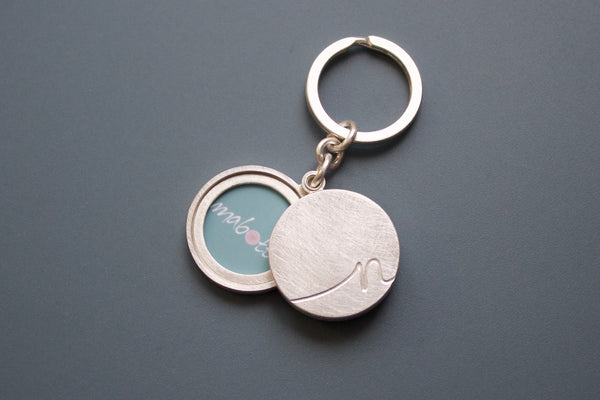 silver keychain locket for two pictures with personalized  initial