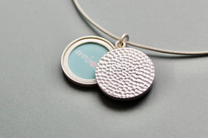 hammered modern locket for two photos in sterling silver