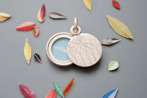 minimalistic silver locket for a small picture forest design