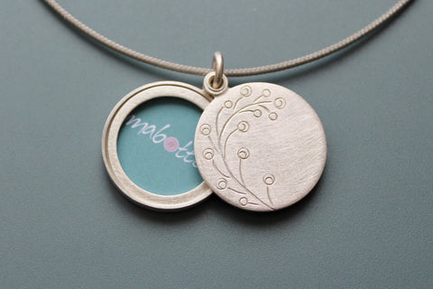 romantic handmade photo locket with twig in sterling silver