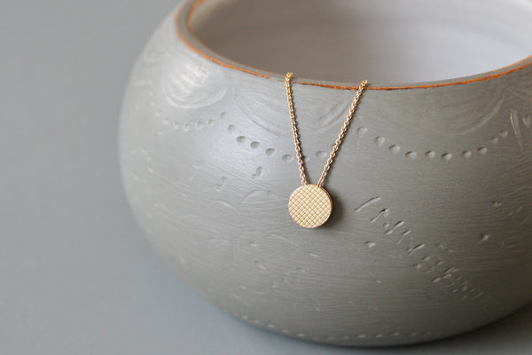 tiny minimalist necklace in 18ct gold with reversible check pattern pendant
