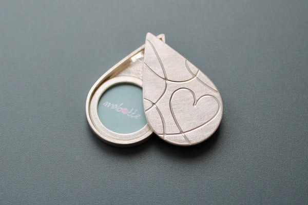 silver drop shaped picture locket with elegant heart design
