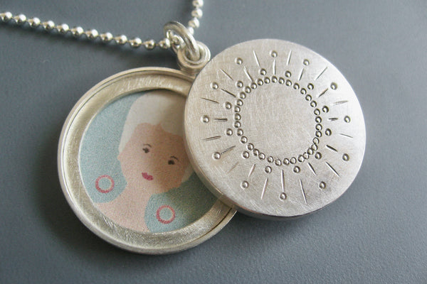 modern two photos locket with sun design in sterling silver