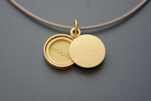 minimalist modern locket for a small photo in 18ct yellow gold