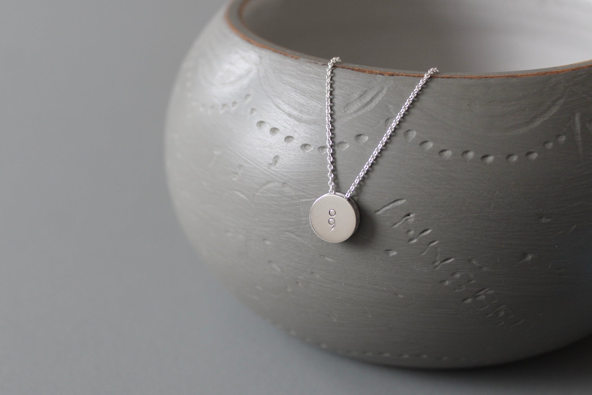 minimalist pendant necklace in sterling silver with semicolon