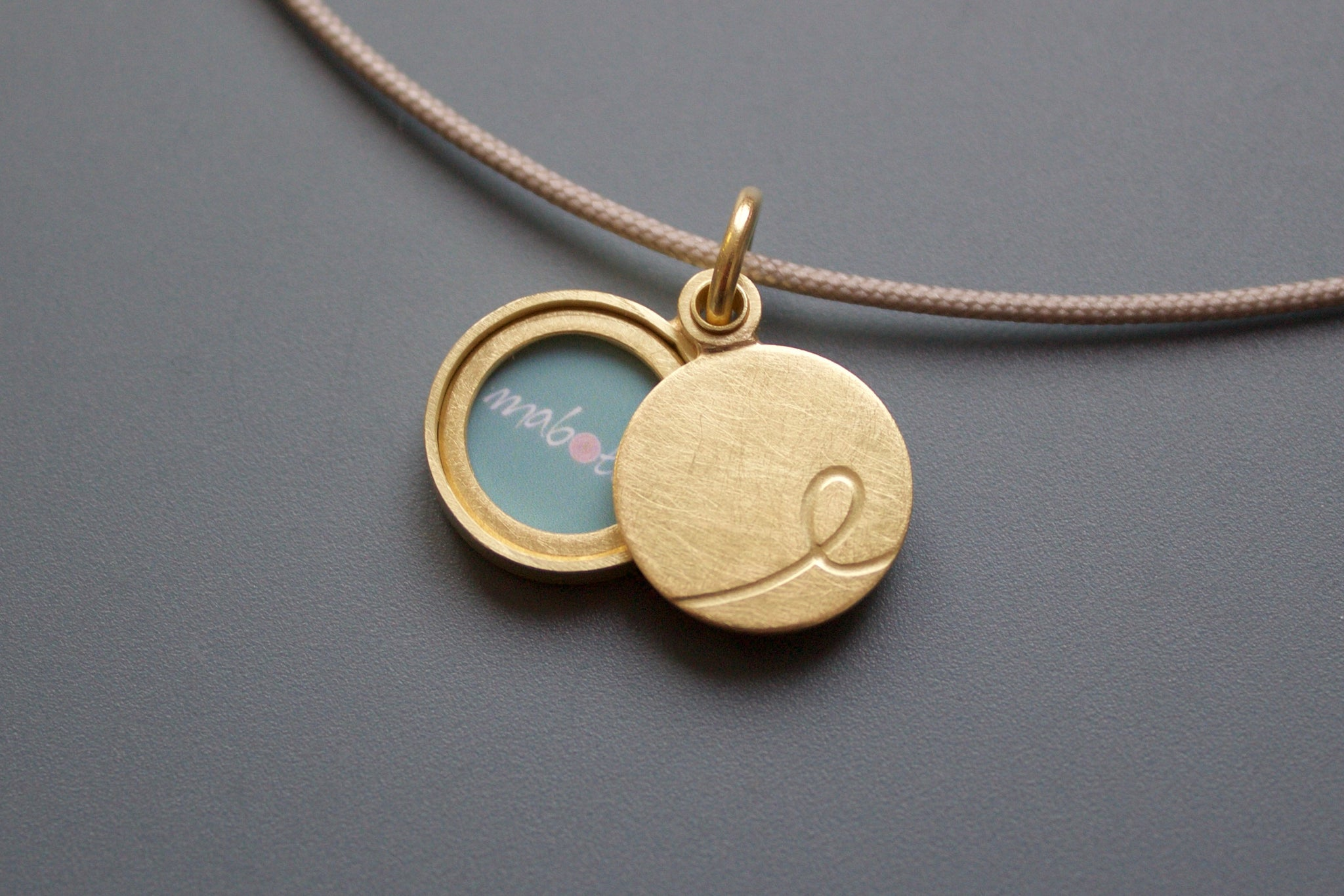 minimalist initial locket made from 18 ct gold