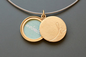 unique golden locket for one photo with custom initial