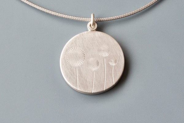 lovely locket for one photo with four dandelions
