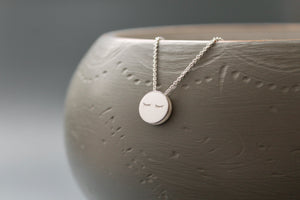 fun necklace with sleepy eyes pendant in sterling silver