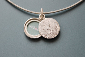modern silver locket for one picture with bubbles design