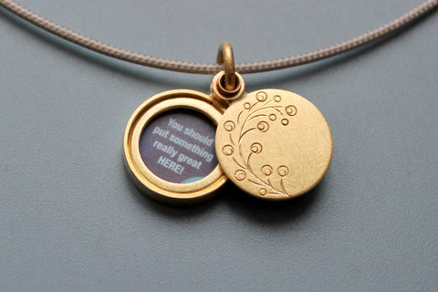 small floral picture locket in 18ct gold with twig