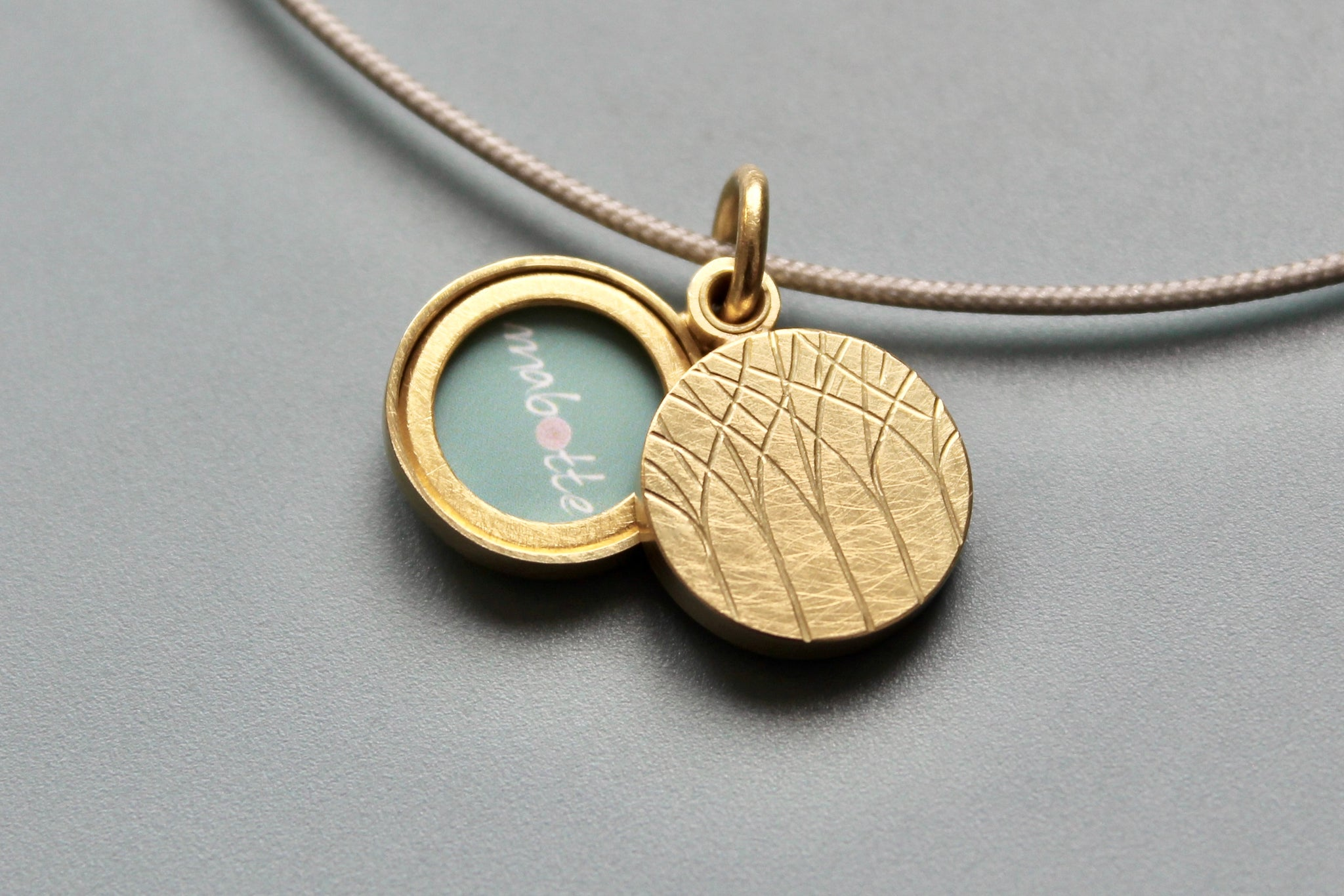 minimalistic golden locket for two small pictures