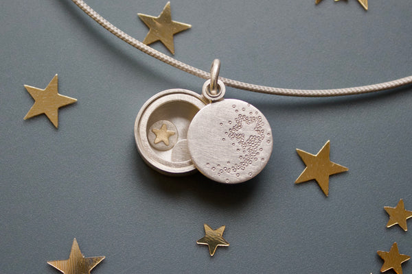 romantic sterling silver glass locket with shooting star
