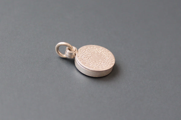 small mabotte locket for one photo in sterling silver with 1000 dots design