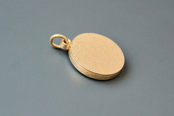 minimalist golden locket for one photo