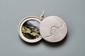 minimalist photo locket with mountain range in sterling silver
