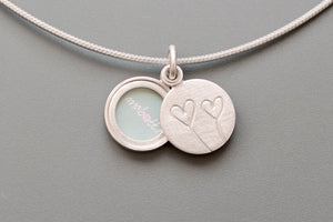 tiny romantic sterling silver photo locket with two hearts
