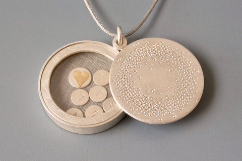 personalized glass locket in sterling silver with 1000 dots design