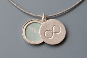 minimalist infinity locket for one picture in sterling silver