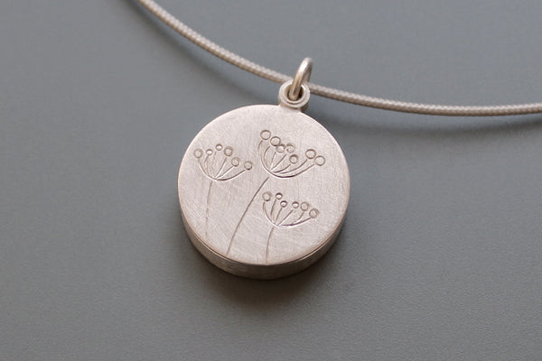 secret message locket filled with letter plates and a golden heart