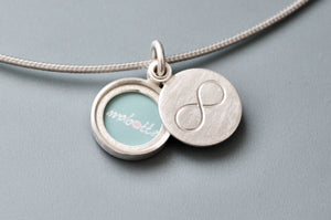 minimalist silver infinity locket for one picture