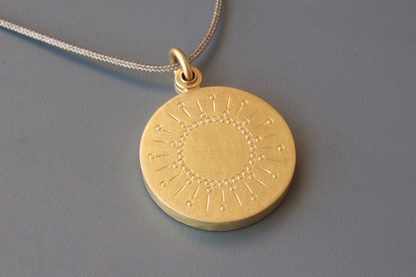 beautiful golden sun locket for one photo