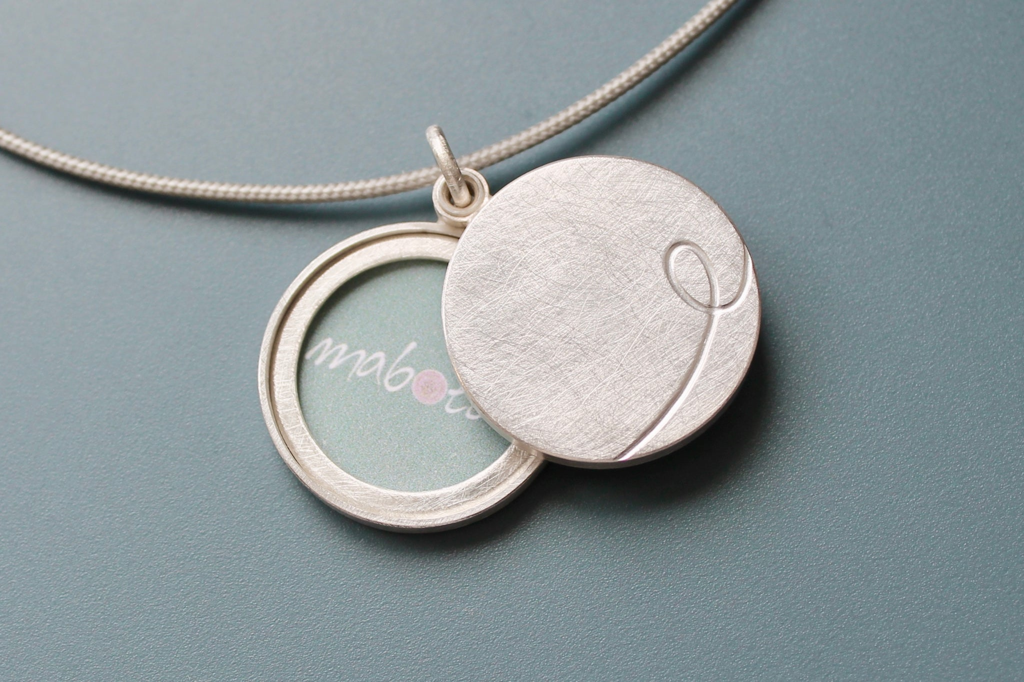 custom initial locket for two photos in sterling silver