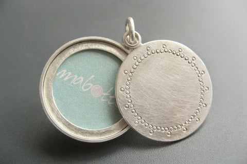 modern silver photo locket with delicate lace pattern