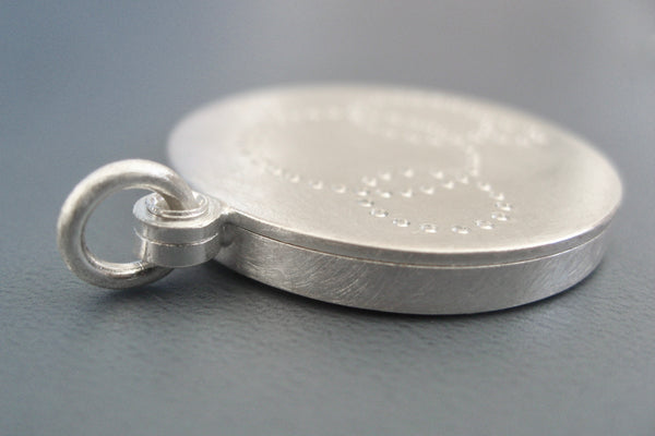 round matt finished picture locket with minimalist design in sterling silver