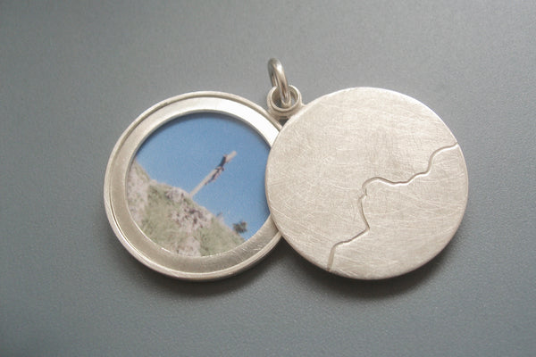 minimalist photo locket with mountain range handmade in sterling silver