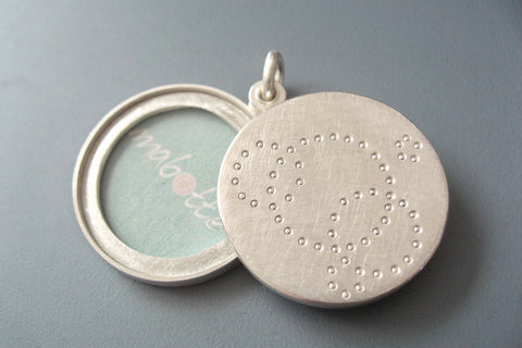 contemporary locket for two pictures handmade in sterling silver