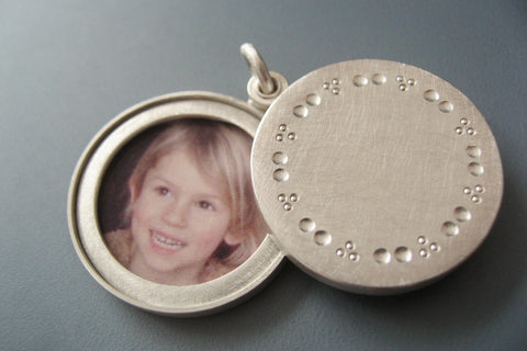 elegant solid silver locket for two pictures with dots pattern