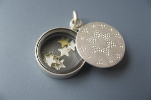 beautiful living locket filled with tiny stars in sterling silver