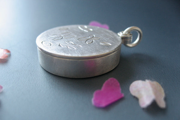 unique living locket with paper butterflies in sterling silver