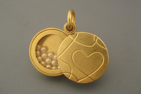 unique golden heart locket filled with cultured pearls