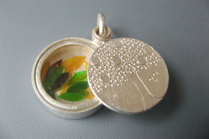 handmade glass locket filled with colorful leaves with family tree design