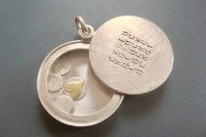 custom glass locket with floating name plates in sterling silver with typographic design