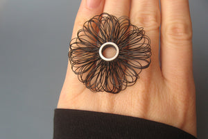 "Ring sterling silver and plastic, Diameter of ring top 40mm, color black, design ""big loops"""
