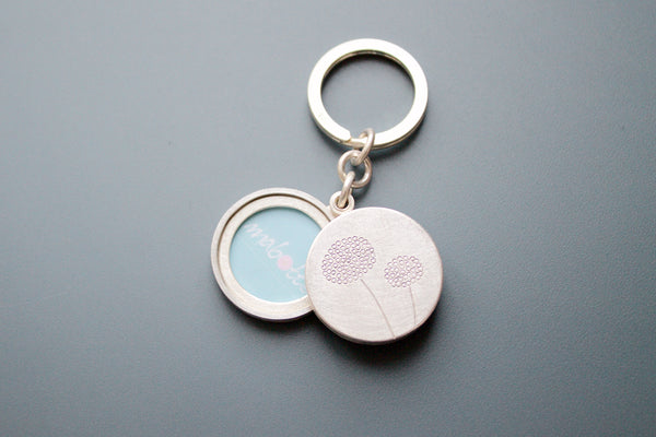 mabotte keyring for two photos in solid sterling silver with dandelions
