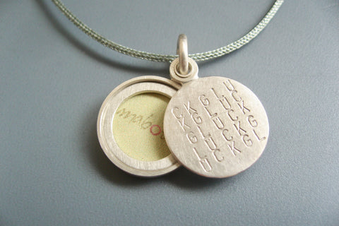 tiny typographic picture locket in sterling silver