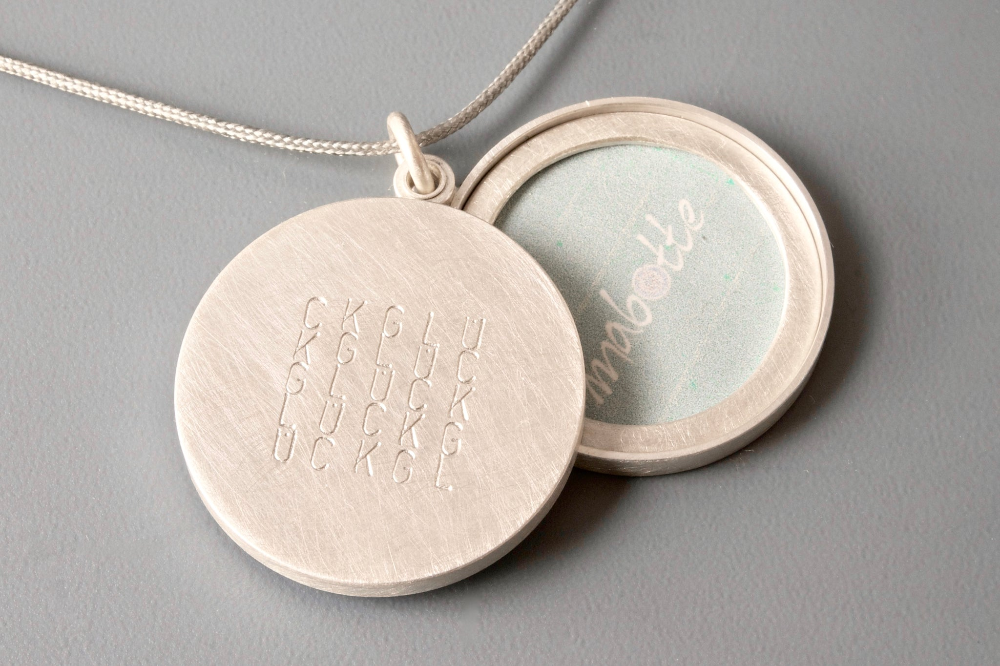 large sterling silver locket for two pictures typographic inscription