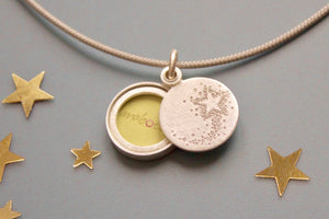 tiny sterling silver photo locket with a shooting star