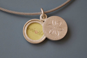 small sterling silver locket for two pictures with dainty flower design