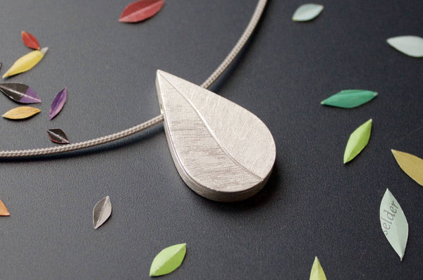 drop shaped  leaf photo pendant handmade in sterling silver