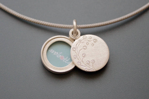 dainty round photo pendant with delicate twig in sterling silver