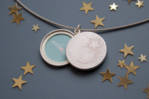wish locket for two photos with shooting star design in sterling silver
