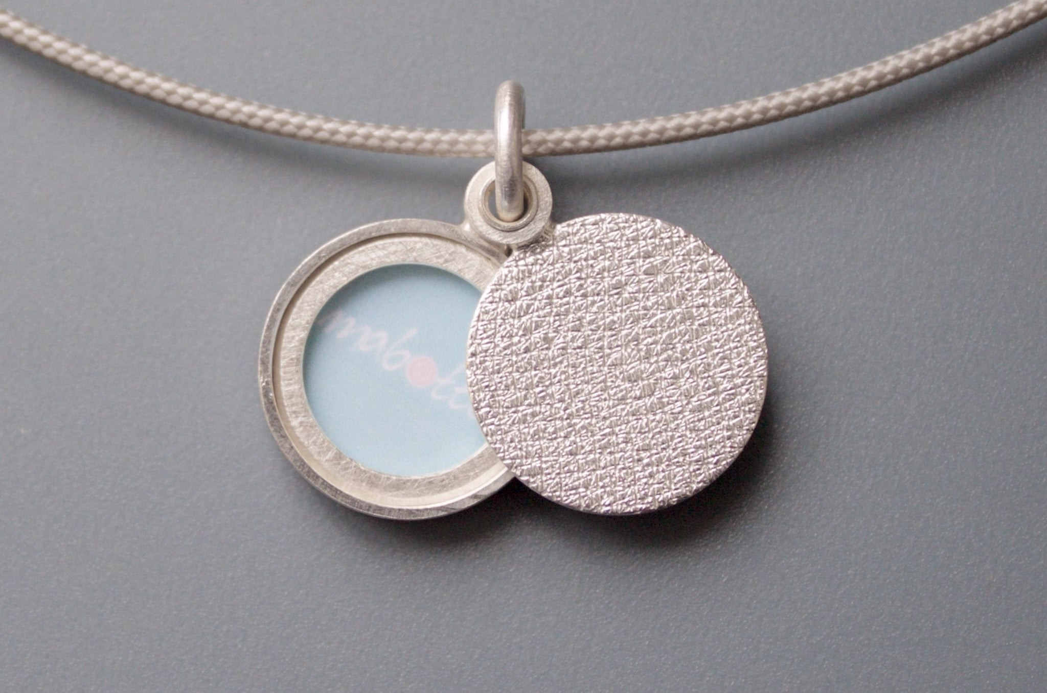 minimalist modern locket for a small photo in structured sterling silver