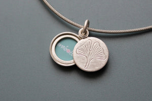 small sterling silver picture locket with gingko leaf