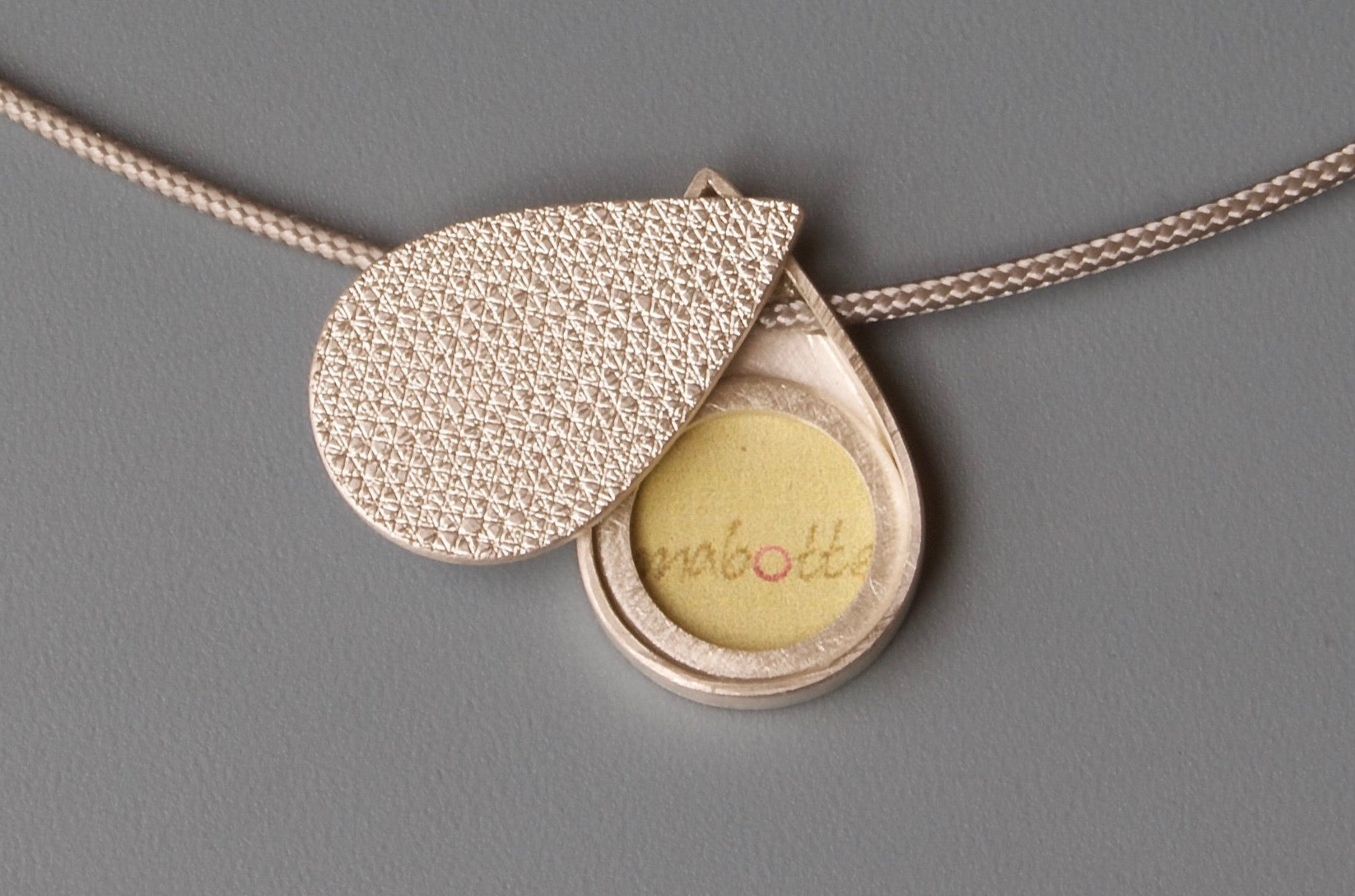 small drop shaped picture locket in unique structured sterling silver